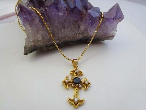 black sapphire & topaz cross